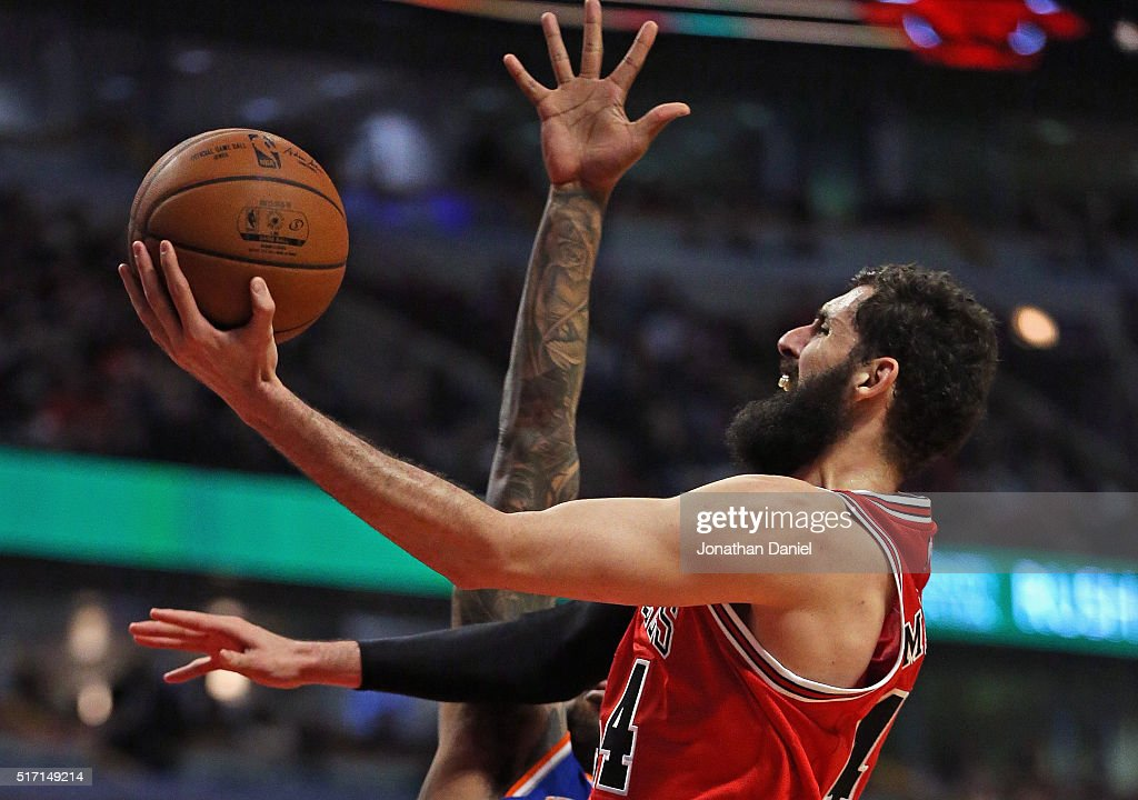 Nikola Mirotic #44 of the Chicago Bulls puts up a shot past of <a gi-track='captionPersonalityLinkClicked' href=/galleries/search?phrase=Derrick+Williams+-+Basketball+Player&family=editorial&specificpeople=11704515 ng-click='$event.stopPropagation()'>Derrick Williams</a> #23 of the New York Knicks on hi s way to a game and career high 35 points at the United Center on March 23, 2016 in Chicago, Illinois. The Knicks defeated the Bulls 115-107.