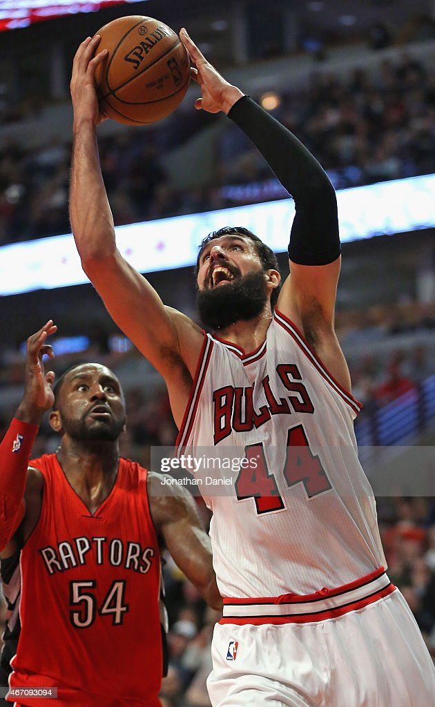 Nikola Mirotic #44 of the Chicago Bulls puts up a shot past <a gi-track='captionPersonalityLinkClicked' href=/galleries/search?phrase=Patrick+Patterson&family=editorial&specificpeople=2928099 ng-click='$event.stopPropagation()'>Patrick Patterson</a> #54 of the Toronto Raptors on his way to a game-high 29 points at the United Center on March 20, 2015 in Chicago, Illinois. The Bulls defeated the Raptors 108-92.