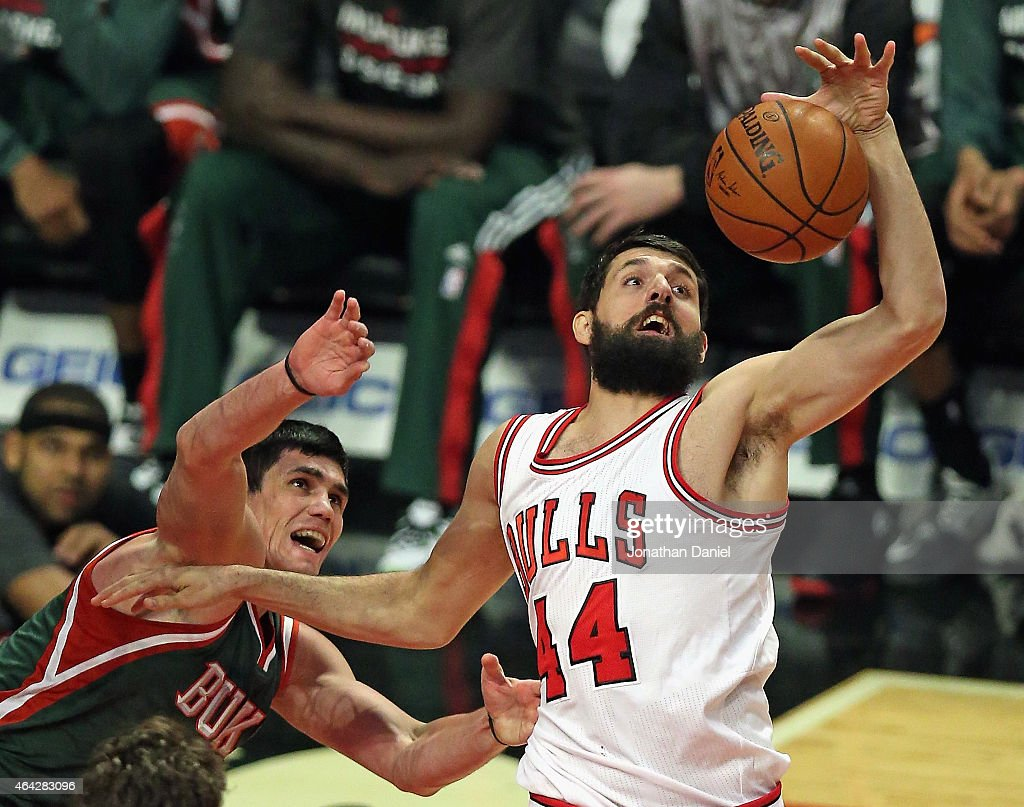 Nikola Mirotic #44 of the Chicago Bulls rebounds over Ersan Ilyasova #7 of the Milwaukee Bucks at the United Center on February 23, 2015 in Chicago, Illinois.