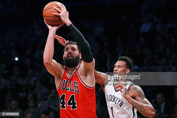 Nikola Mirotic of the Chicago Bulls shoots a jumper against Chris McCullough of the Brooklyn Nets during the second half at Barclays Center on...