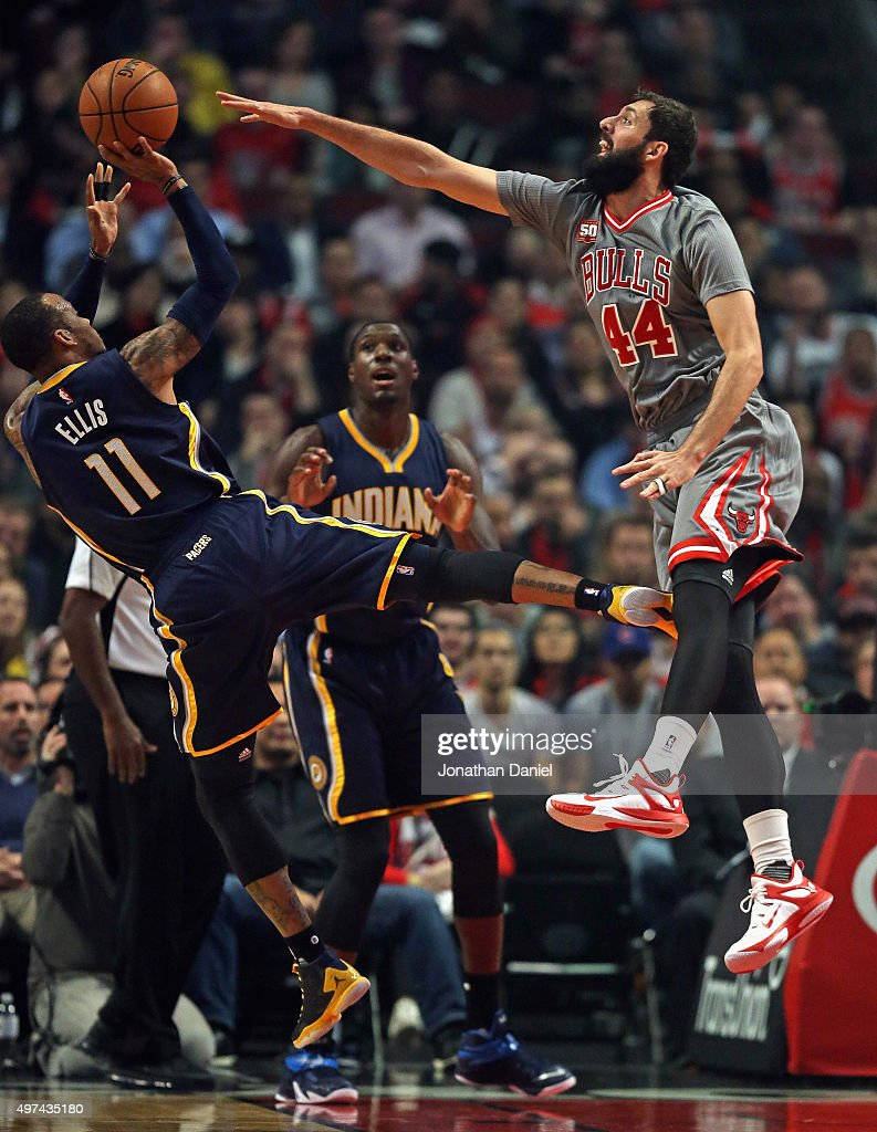 Nikola Mirotic #44 of the Chicago Bulls tries to block a shot by <a gi-track='captionPersonalityLinkClicked' href=/galleries/search?phrase=Monta+Ellis&family=editorial&specificpeople=567403 ng-click='$event.stopPropagation()'>Monta Ellis</a> #11 of the Indiana Pacers at the United Center on November 16, 2015 in Chicago, Illinois. Note to User: User expressly acknowledges and agrees that, by downloading and or using the photograph, User is consenting to the terms and conditions of the Getty Images License Agreement.