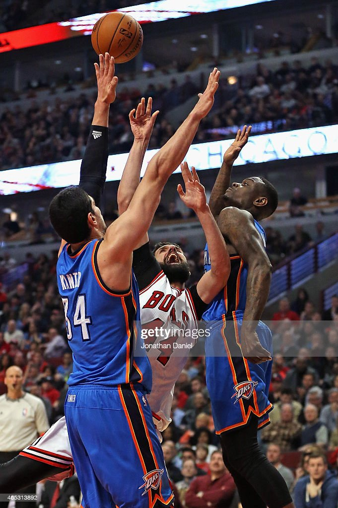 Nikola Mirotic #44 of the Chicago Bulls tries to get off a shot between <a gi-track='captionPersonalityLinkClicked' href=/galleries/search?phrase=Enes+Kanter&family=editorial&specificpeople=5621416 ng-click='$event.stopPropagation()'>Enes Kanter</a> #34 and <a gi-track='captionPersonalityLinkClicked' href=/galleries/search?phrase=Anthony+Morrow&family=editorial&specificpeople=814354 ng-click='$event.stopPropagation()'>Anthony Morrow</a> #2 of the Oklahoma City Thunder at the United Center on March 5, 2015 in Chicago, Illinois. The Bulls defeated the Thunder 108-105.