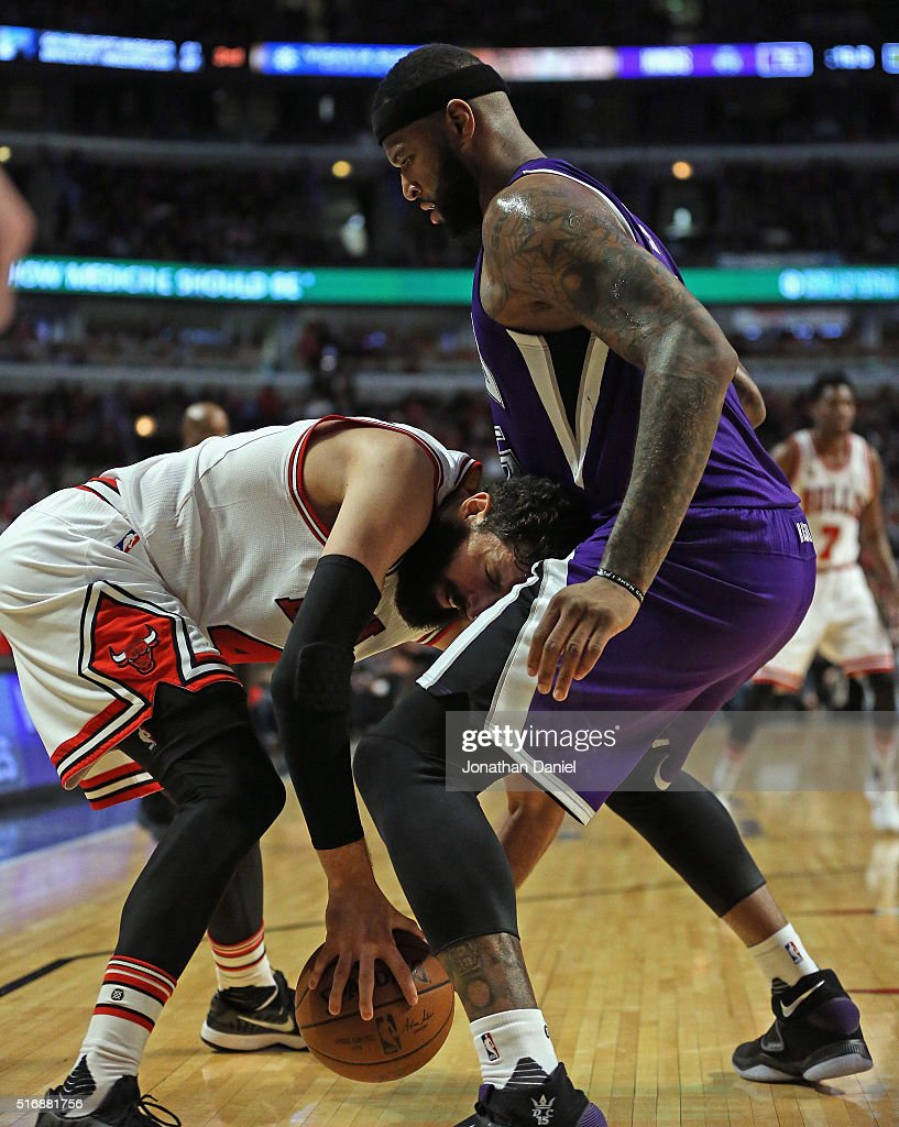 Nikola Mirotic #44 of the Chicago Bulls tries to move against <a gi-track='captionPersonalityLinkClicked' href=/galleries/search?phrase=DeMarcus+Cousins&family=editorial&specificpeople=5792008 ng-click='$event.stopPropagation()'>DeMarcus Cousins</a> #15 of the Sacramento Kings at the United Center on March 21, 2016 in Chicago, Illinois. The Bulls defeated the Kings 109-102.