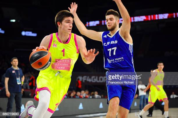 Nikola Miskovic #1 of Mega Bemax Belgrade competes with Ivan Fevrier #77 of U18 CFBB Paris during the EuroLeague Basketball Adidas Next Generation...