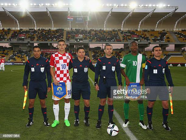 Nikola Moro of Croatia and Kelechi Nwakali of Nigeria pose with the officials prior to the FIFA U17 World Cup Group A match between Croatia and...
