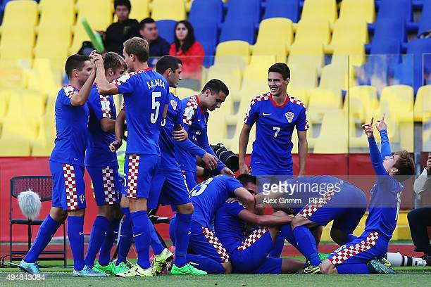 Nikola Moro of Croatia celebrates his team's first goal with team mates during the FIFA U17 World Cup Chile 2015 Round of 16 match between Croatia...