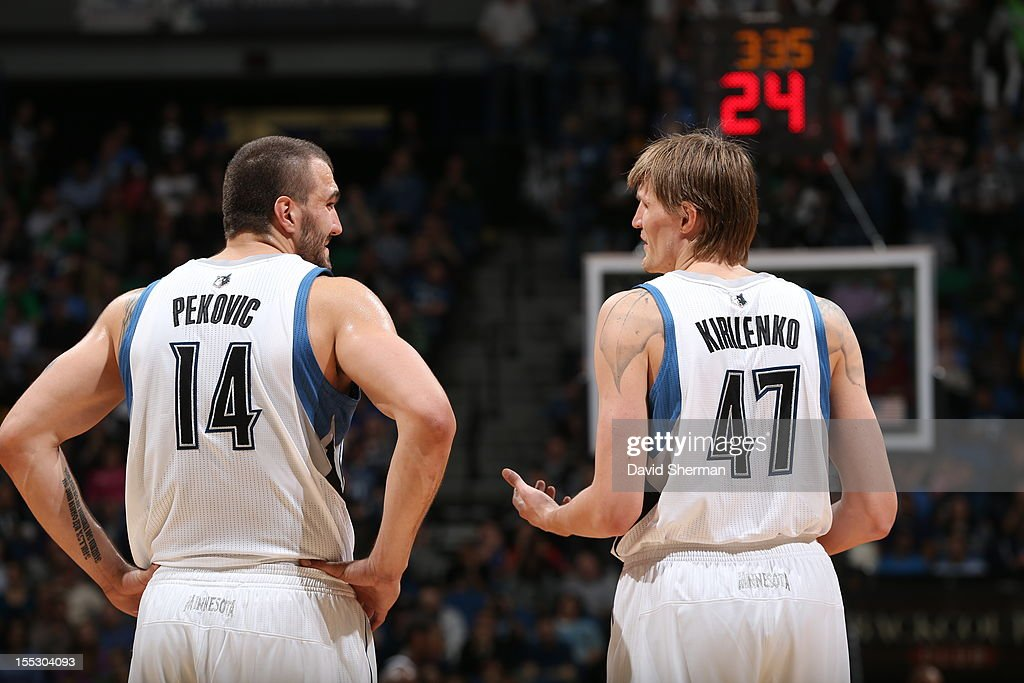 Nikola Pekovic #14 and Andrei Kirilenko #47 of the Minnesota Timberwolves look on against the Sacramento Kings during the season opening game on November 2, 2012 at Target Center in Minneapolis, Minnesota.