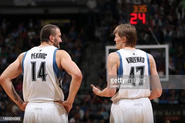 Nikola Pekovic and Andrei Kirilenko of the Minnesota Timberwolves look on against the Sacramento Kings during the season opening game on November 2...