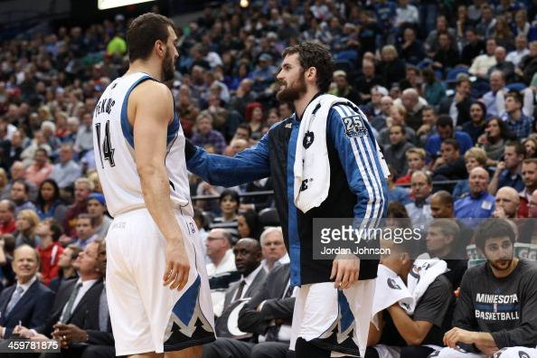 Nikola Pekovic and Kevin Love of the Minnesota Timberwolves talk during the game against the Portland Trail Blazers on December 18 2013 at Target...