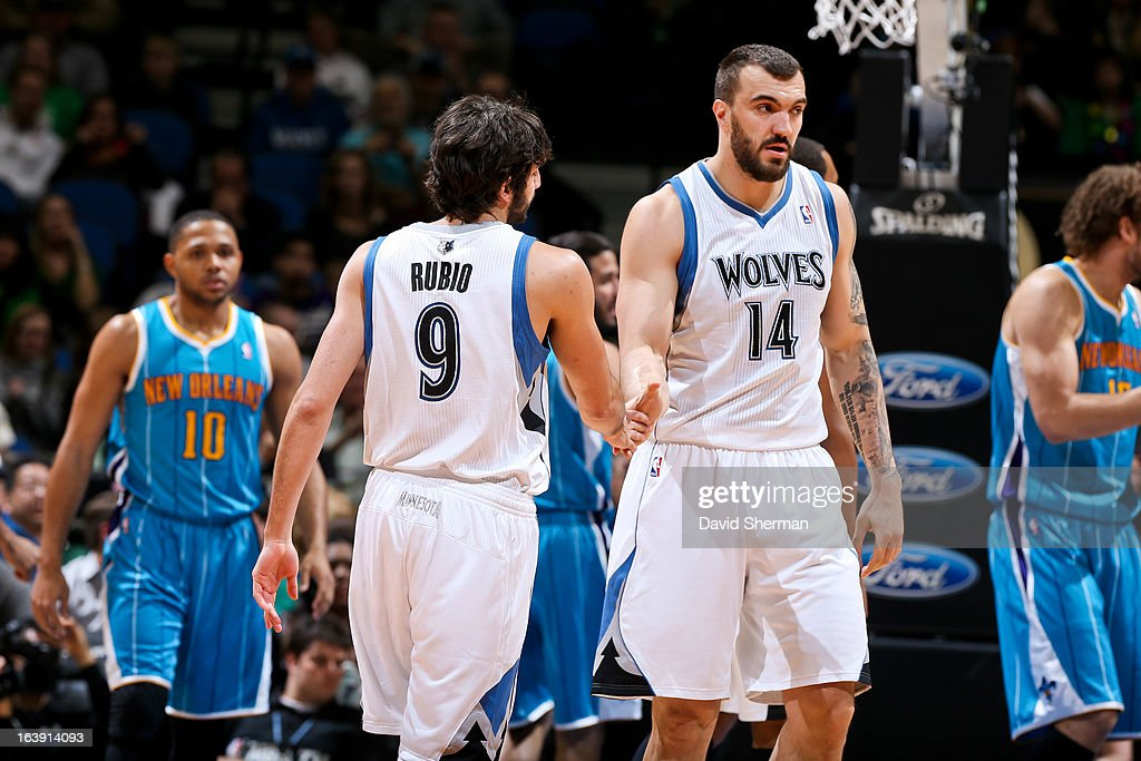 Nikola Pekovic #14 and Ricky Rubio #9 of the Minnesota Timberwolves celebrate during a game against the New Orleans Hornets on March 17, 2013 at Target Center in Minneapolis, Minnesota.