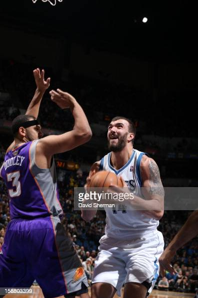 Nikola Pekovic of the Minnesota Timberwolves aims to the basket against Jared Dudley of the Phoenix Suns during the game between the Minnesota...