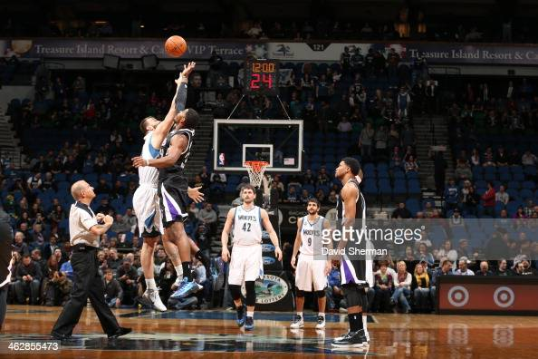 Nikola Pekovic of the Minnesota Timberwolves and Jason Thompson of the Sacramento Kings tip off the game on January 15 2014 at Target Center in...