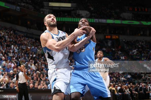 Nikola Pekovic of the Minnesota Timberwolves and Kenneth Faried of the Denver Nuggets wait for a rebound uring the game between the Minnesota...