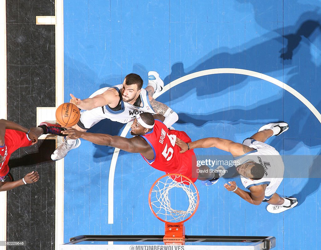 Nikola Pekovic #14 of the Minnesota Timberwolves and Kwame Brown #54 of the Philadelphia 76ers battle for the ball control during the game between Philadelphia 76ers and the Minnesota Timberwolves on February 20, 2013 at Target Center in Minneapolis, Minnesota.
