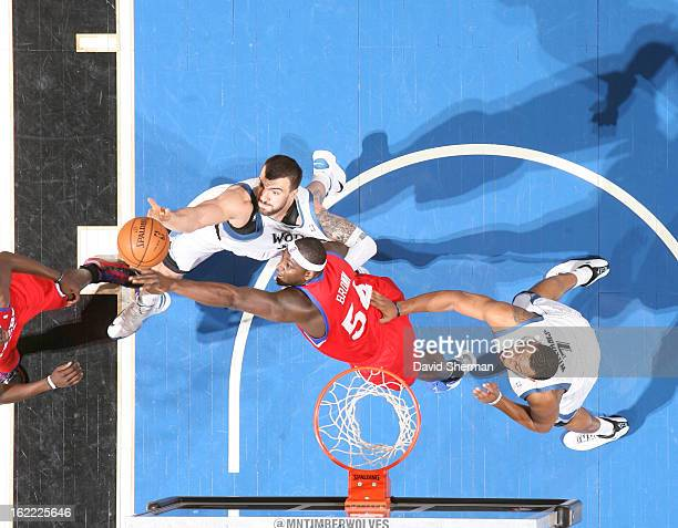 Nikola Pekovic of the Minnesota Timberwolves and Kwame Brown of the Philadelphia 76ers battle for the ball control during the game between...