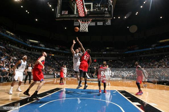 Nikola Pekovic of the Minnesota Timberwolves and Lavoy Allen of the Philadelphia 76ers battle for the ball control during the game between...
