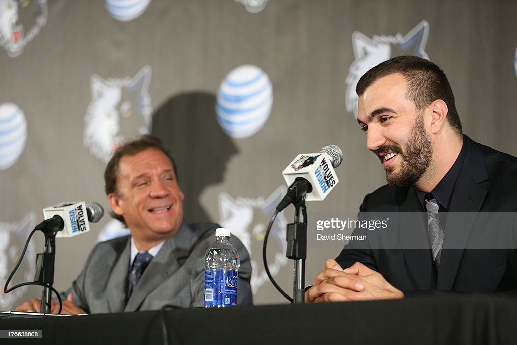 Nikola Pekovic of the Minnesota Timberwolves and Phil 'Flip' Saunders, President of Basketball Operations hold a press conference announcing Pekovic's contract re-signing on August 16, 2013 at Target Center in Minneapolis, Minnesota.