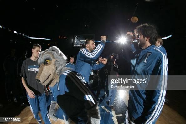 Nikola Pekovic of the Minnesota Timberwolves and Ricky Rubio of the Minnesota Timberwolves greet teammates beforethe game between Philadelphia 76ers...