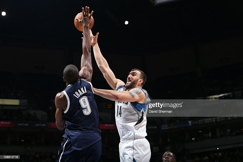 <a gi-track='captionPersonalityLinkClicked' href=/galleries/search?phrase=Nikola+Pekovic&family=editorial&specificpeople=829137 ng-click='$event.stopPropagation()'>Nikola Pekovic</a> #14 of the Minnesota Timberwolves and <a gi-track='captionPersonalityLinkClicked' href=/galleries/search?phrase=Serge+Ibaka&family=editorial&specificpeople=5133378 ng-click='$event.stopPropagation()'>Serge Ibaka</a> #9 of the Oklahoma City Thunder fight for a jump ball on December 20, 2012 at Target Center in Minneapolis, Minnesota.