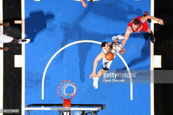 Nikola Pekovic of the Minnesota Timberwolves and Spencer Hawes of the Philadelphia 76ers battle for the ball control during the game between...
