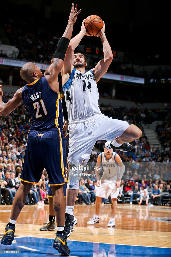 Nikola Pekovic #14 of the Minnesota Timberwolves attempts a shot against David West #21 of the Indiana Pacers on November 9, 2012 at Target Center in Minneapolis, Minnesota.
