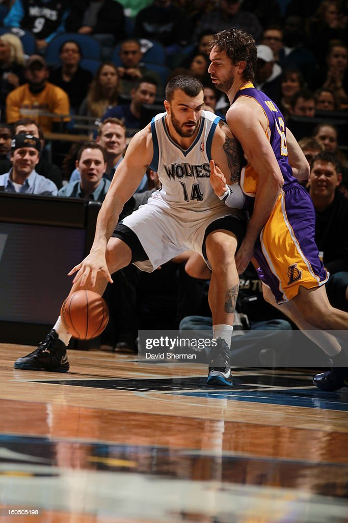 Nikola Pekovic #14 of the Minnesota Timberwolves backs up Pau Gasol #16 against the Los Angeles Lakers during the game on February 1, 2013 at Target Center in Minneapolis, Minnesota.