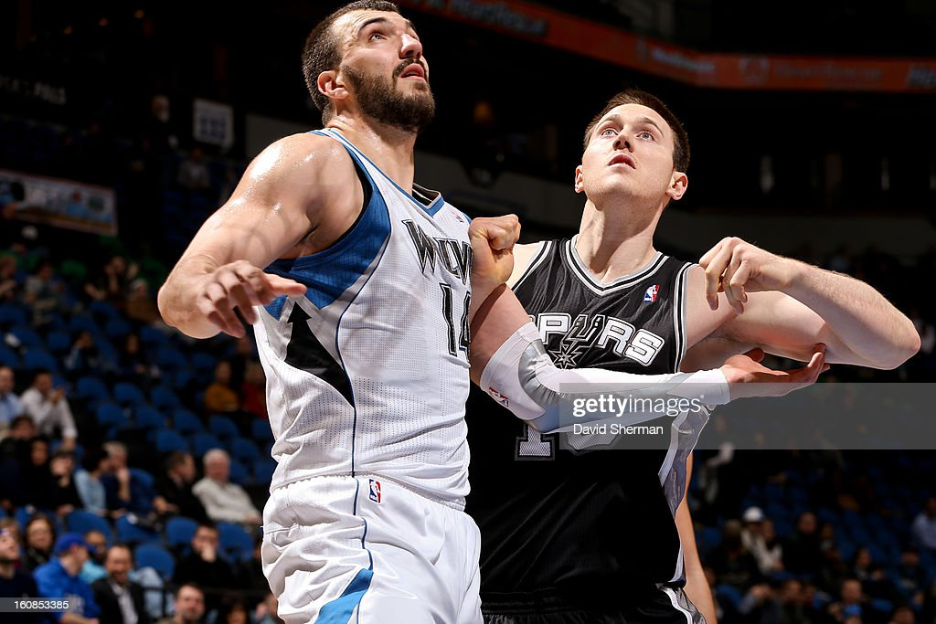 Nikola Pekovic #14 of the Minnesota Timberwolves battles for rebound position against Aron Baynes #16 of the San Antonio Spurs on February 6, 2013 at Target Center in Minneapolis, Minnesota.
