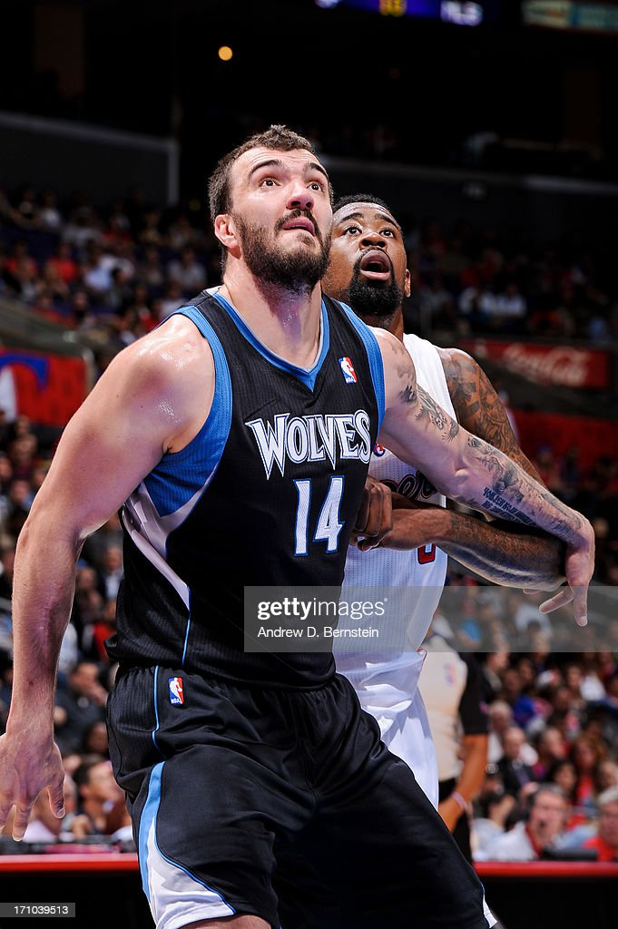 <a gi-track='captionPersonalityLinkClicked' href=/galleries/search?phrase=Nikola+Pekovic&family=editorial&specificpeople=829137 ng-click='$event.stopPropagation()'>Nikola Pekovic</a> #14 of the Minnesota Timberwolves battles for rebound position against <a gi-track='captionPersonalityLinkClicked' href=/galleries/search?phrase=DeAndre+Jordan&family=editorial&specificpeople=4665718 ng-click='$event.stopPropagation()'>DeAndre Jordan</a> #6 of the Los Angeles Clippers at Staples Center on April 10, 2013 in Los Angeles, California.