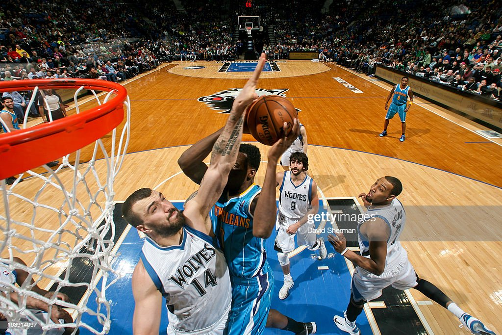 Nikola Pekovic #14 of the Minnesota Timberwolves contests a shot attempt by Al-Farouq Aminu #0 of the New Orleans Hornets on March 17, 2013 at Target Center in Minneapolis, Minnesota.