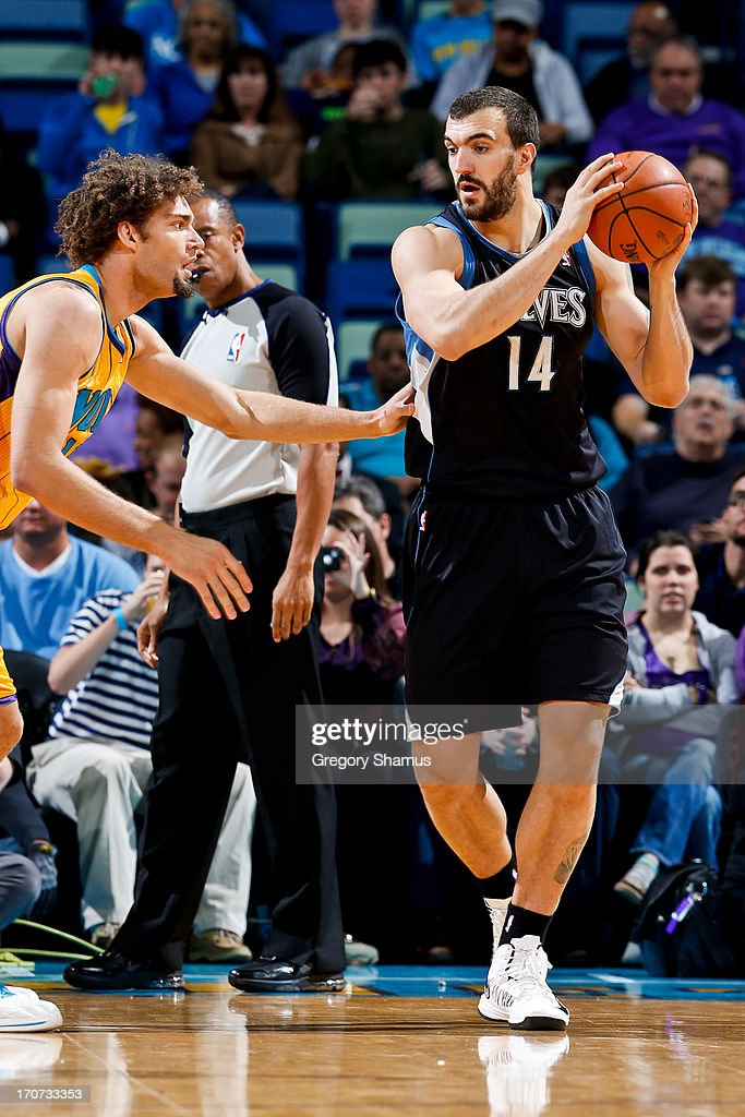 <a gi-track='captionPersonalityLinkClicked' href=/galleries/search?phrase=Nikola+Pekovic&family=editorial&specificpeople=829137 ng-click='$event.stopPropagation()'>Nikola Pekovic</a> #14 of the Minnesota Timberwolves controls the ball against <a gi-track='captionPersonalityLinkClicked' href=/galleries/search?phrase=Robin+Lopez&family=editorial&specificpeople=2351509 ng-click='$event.stopPropagation()'>Robin Lopez</a> #15 of the New Orleans Hornets on December 14, 2012 at the New Orleans Arena in New Orleans, Louisiana.
