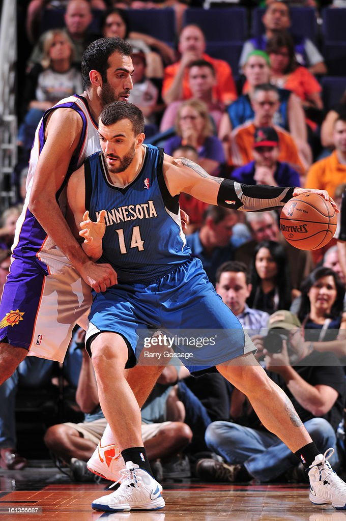 Nikola Pekovic #14 of the Minnesota Timberwolves drives against Hamed Haddadi #98 of the Phoenix Suns on March 22, 2013 at U.S. Airways Center in Phoenix, Arizona.