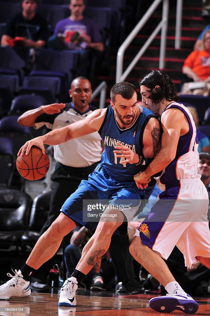 Nikola Pekovic #14 of the Minnesota Timberwolves drives against Luis Scola #14 of the Phoenix Suns on March 22, 2013 at U.S. Airways Center in Phoenix, Arizona.