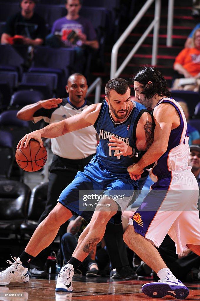 Nikola Pekovic #14 of the Minnesota Timberwolves drives against Luis Scola #14 of the Phoenix Suns on March 22, 2013 at U.S. Airways Center in Phoenix, Arizona.