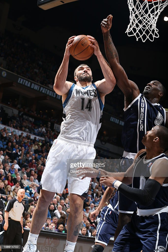 <a gi-track='captionPersonalityLinkClicked' href=/galleries/search?phrase=Nikola+Pekovic&family=editorial&specificpeople=829137 ng-click='$event.stopPropagation()'>Nikola Pekovic</a> #14 of the Minnesota Timberwolves drives to the basket against the Oklahoma City Thunder on December 20, 2012 at Target Center in Minneapolis, Minnesota.