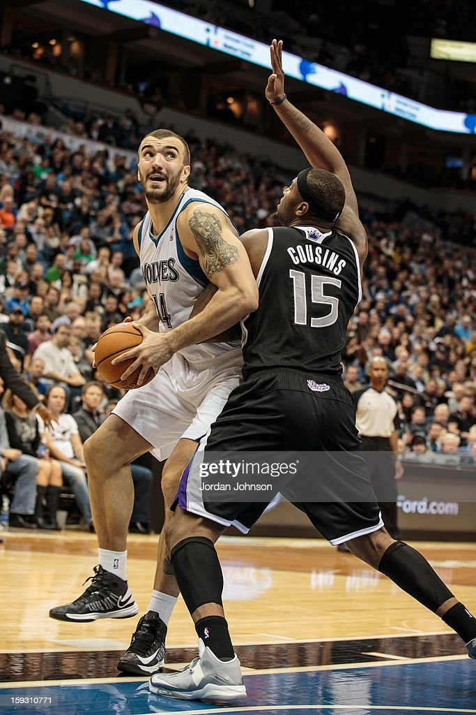 Nikola Pekovic #14 of the Minnesota Timberwolves drives to the basket against DeMarcus Cousins #15 of the Sacramento Kings during the season opening game on November 2, 2012 at Target Center in Minneapolis, Minnesota.