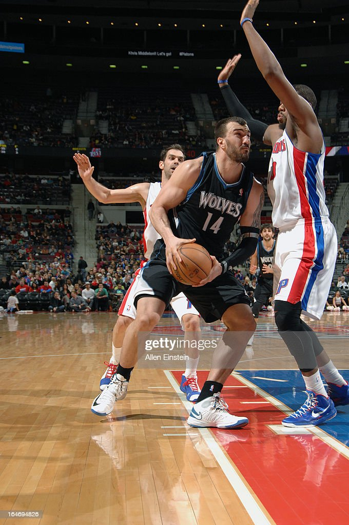 Nikola Pekovic #14 of the Minnesota Timberwolves drives to the basket against the Detroit Pistons during the game on March 26, 2013 at The Palace of Auburn Hills in Auburn Hills, Michigan.
