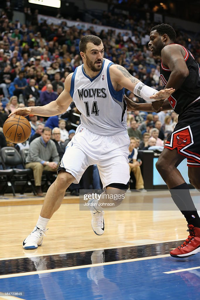 <a gi-track='captionPersonalityLinkClicked' href=/galleries/search?phrase=Nikola+Pekovic&family=editorial&specificpeople=829137 ng-click='$event.stopPropagation()'>Nikola Pekovic</a> #14 of the Minnesota Timberwolves drives to the basket against the Chicago Bulls on March 24, 2013 at Target Center in Minneapolis, Minnesota.
