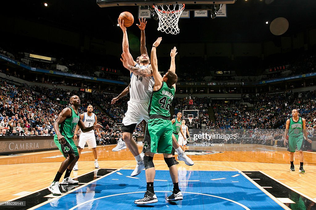 <a gi-track='captionPersonalityLinkClicked' href=/galleries/search?phrase=Nikola+Pekovic&family=editorial&specificpeople=829137 ng-click='$event.stopPropagation()'>Nikola Pekovic</a> #14 of the Minnesota Timberwolves drives to the basket against <a gi-track='captionPersonalityLinkClicked' href=/galleries/search?phrase=Shavlik+Randolph&family=editorial&specificpeople=210678 ng-click='$event.stopPropagation()'>Shavlik Randolph</a> #42 of the Boston Celtics on April 1, 2013 at Target Center in Minneapolis, Minnesota.