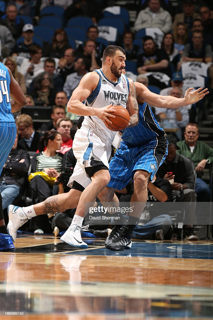 Nikola Pekovic #14 of the Minnesota Timberwolves drives to the basket against the Orlando Magic during the season and home opening game on October 30, 2013 at Target Center in Minneapolis, Minnesota.
