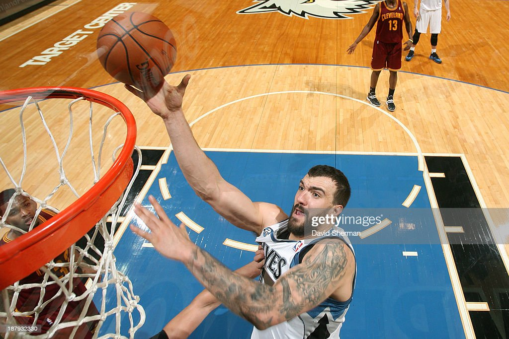 Nikola Pekovic #14 of the Minnesota Timberwolves drives to the basket against the Cleveland Cavaliers on November 13, 2013 at Target Center in Minneapolis, Minnesota.