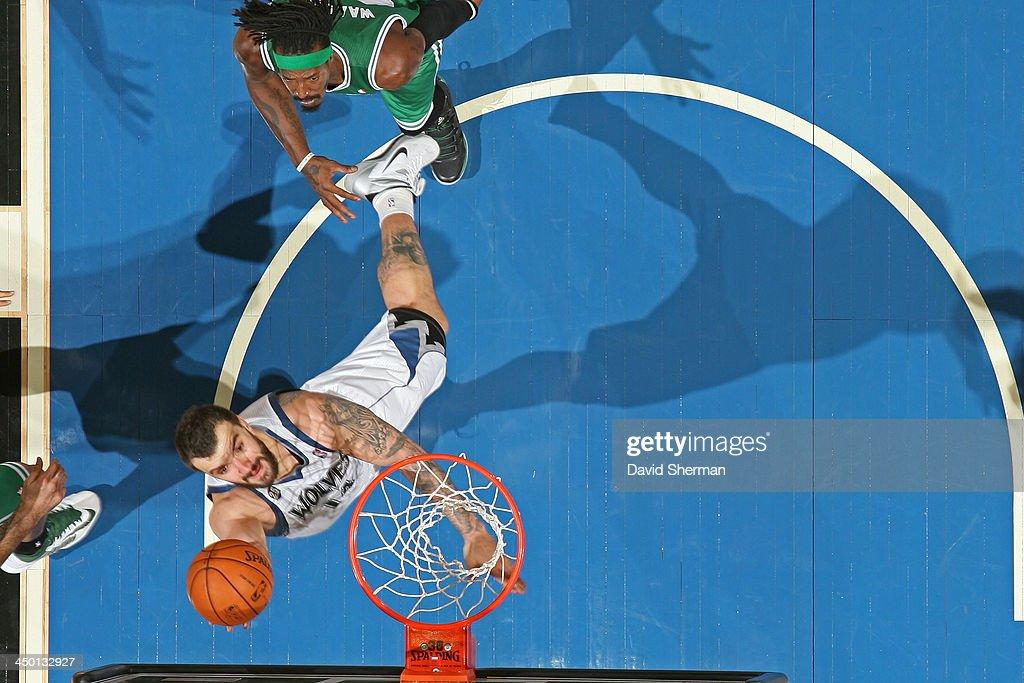 Nikola Pekovic #14 of the Minnesota Timberwolves drives to the basket against the Boston Celtics on November 16, 2013 at Target Center in Minneapolis, Minnesota.