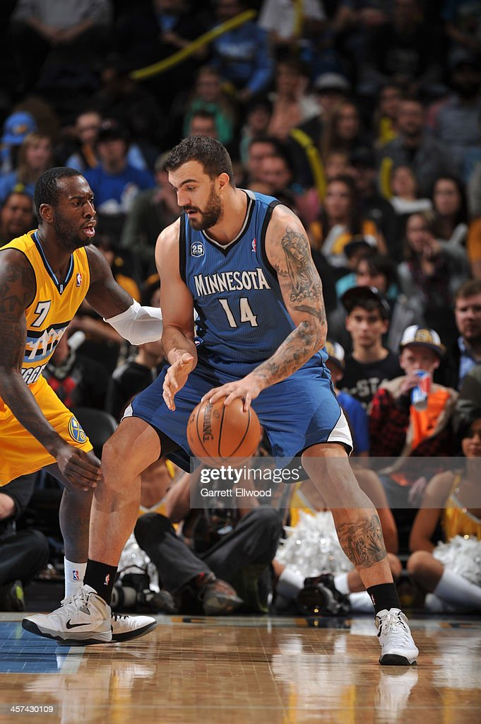 Nikola Pekovic #14 of the Minnesota Timberwolves drives to the basket against the Denver Nuggets on November 15, 2013 at the Pepsi Center in Denver, Colorado.