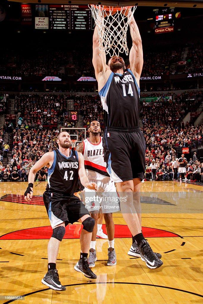 Nikola Pekovic #14 of the Minnesota Timberwolves dunks against the Portland Trail Blazers on November 23, 2012 at the Rose Garden Arena in Portland, Oregon.