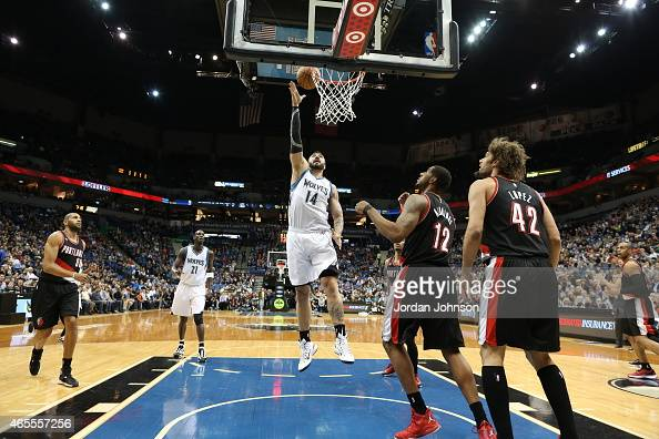 Nikola Pekovic of the Minnesota Timberwolves dunks against the Portland Trail Blazers during the game on March 7 2015 at Target Center in Minneapolis...