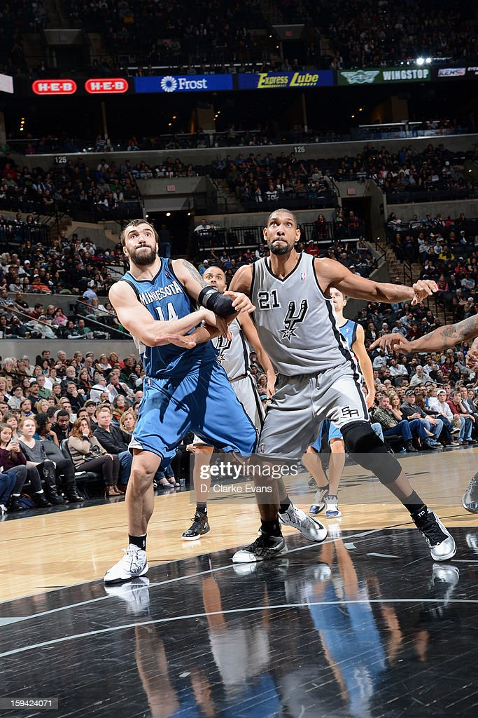 Nikola Pekovic #14 of the Minnesota Timberwolves fights for position against Tim Duncan #21 of the San Antonio Spurs on January 13, 2013 at the AT&T Center in San Antonio, Texas.