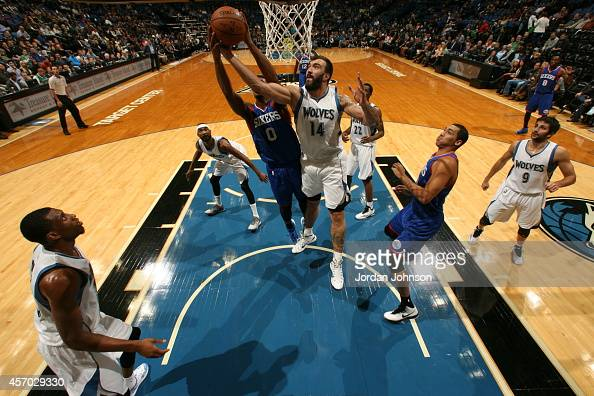 Nikola Pekovic of the Minnesota Timberwolves goes for the rebound against the Philadelphia 76ers during the game on October 10 2014 at Target Center...