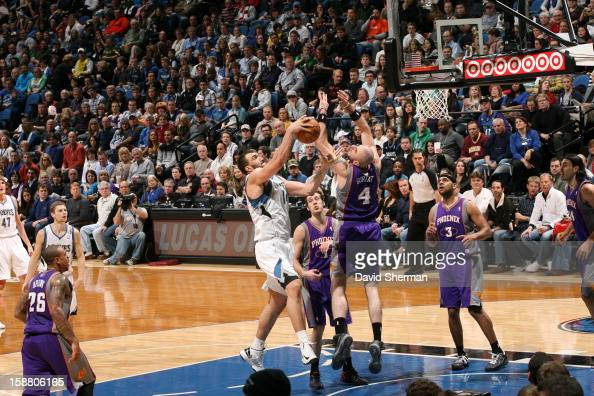 Nikola Pekovic of the Minnesota Timberwolves goes to the basket against Marcin Gortat of the Phoenix Suns during the game between the Minnesota...