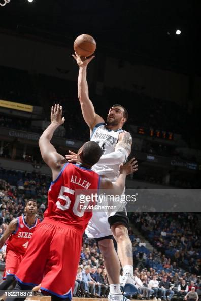 Nikola Pekovic of the Minnesota Timberwolves goes to the basket against Lavoy Allen of the Philadelphia 76ers during the game between Philadelphia...