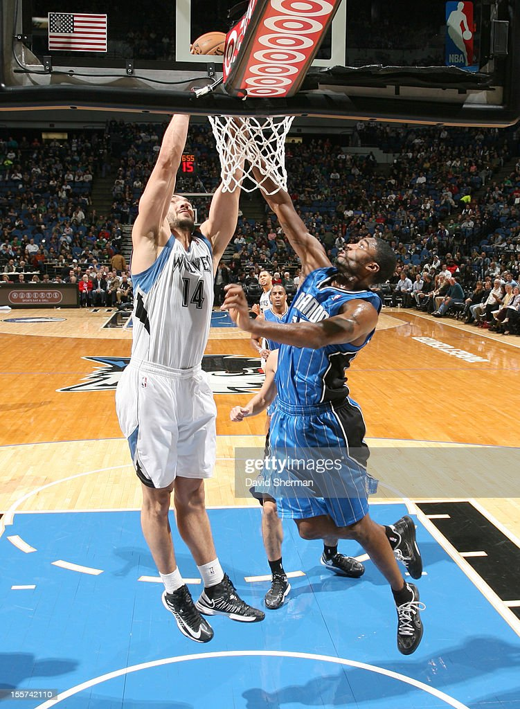 Nikola Pekovic #14 of the Minnesota Timberwolves goes to the basket against defense during the game between the Minnesota Timberwolves and the Orlando Magic on November 7, 2012 at Target Center in Minneapolis, Minnesota.