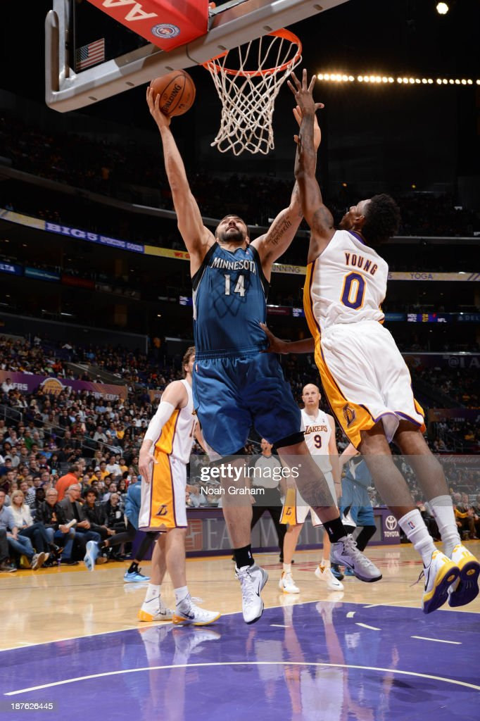 Nikola Pekovic #14 of the Minnesota Timberwolves goes up for a shot against Nick Young #0 of the Los Angeles Lakers at Staples Center on November 10, 2013 in Los Angeles, California.